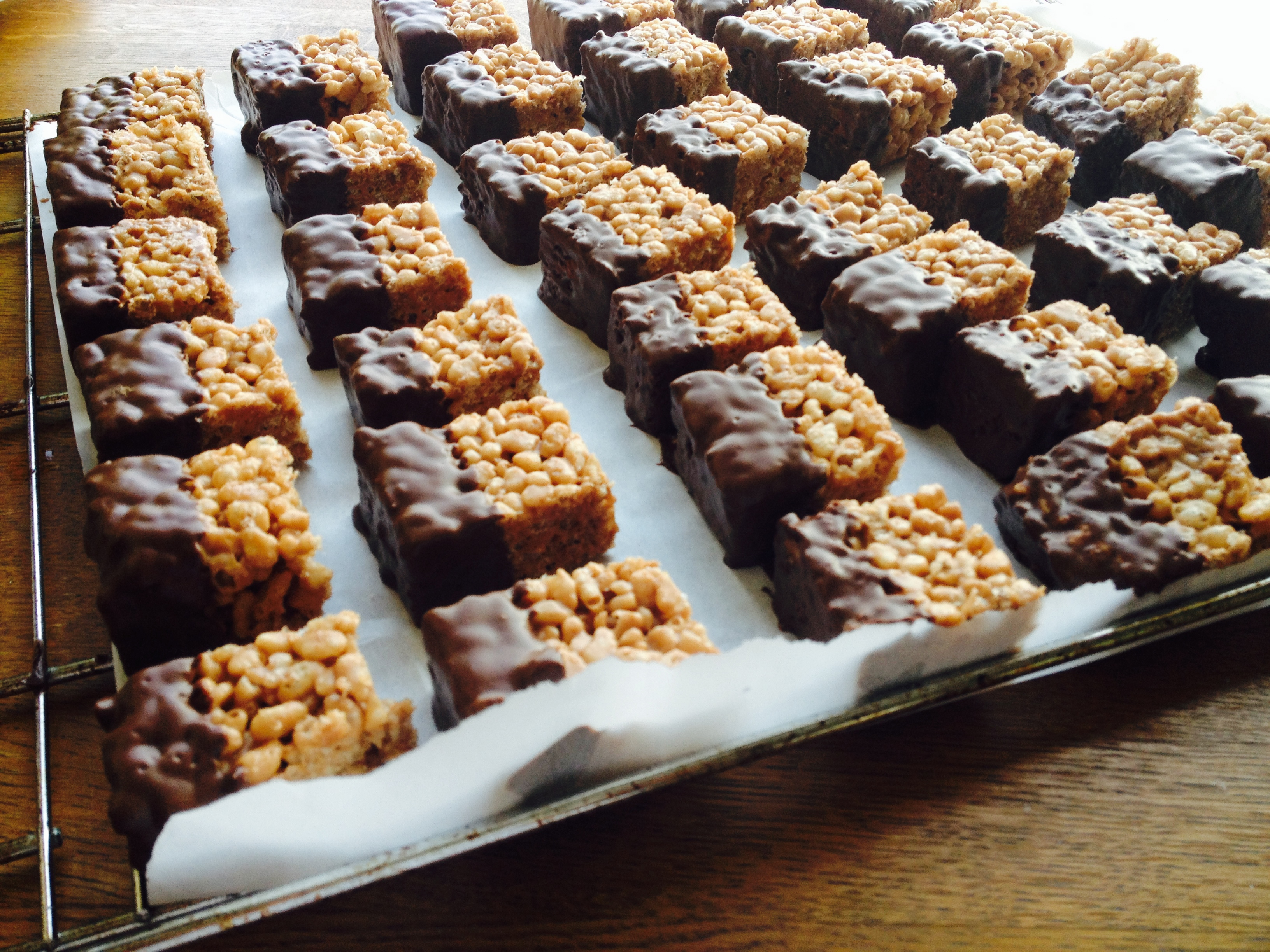 Chocolate dipped rice crispie caramel squares
